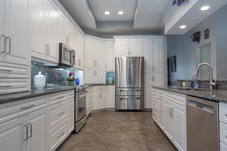 Transitional Kitchen With A Tray Ceiling And White Cabinetry