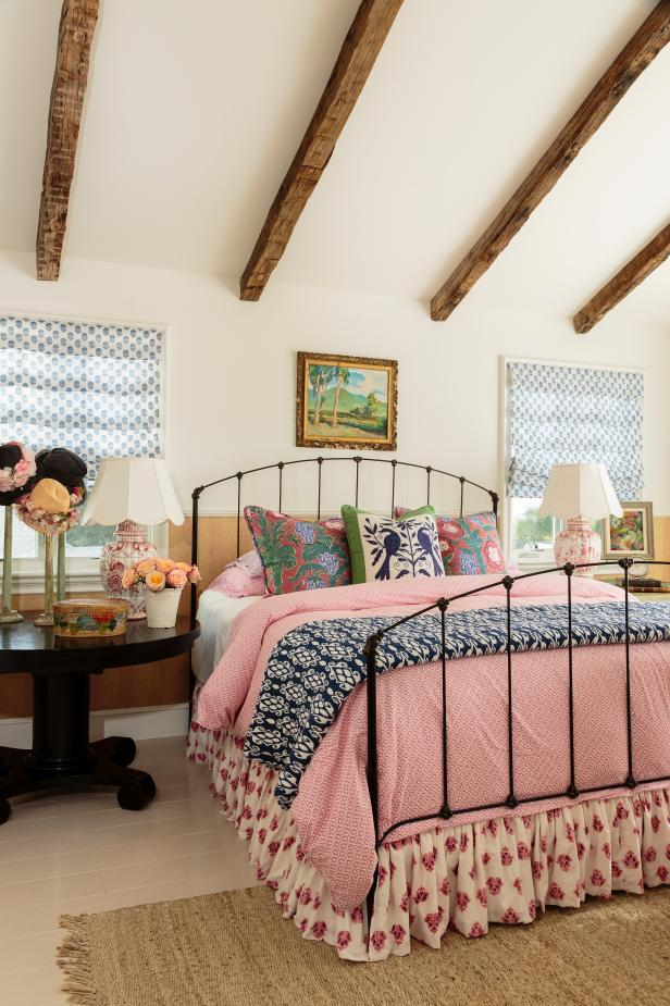 Colorful Bedroom with Pink Bedspread and Blue Accents