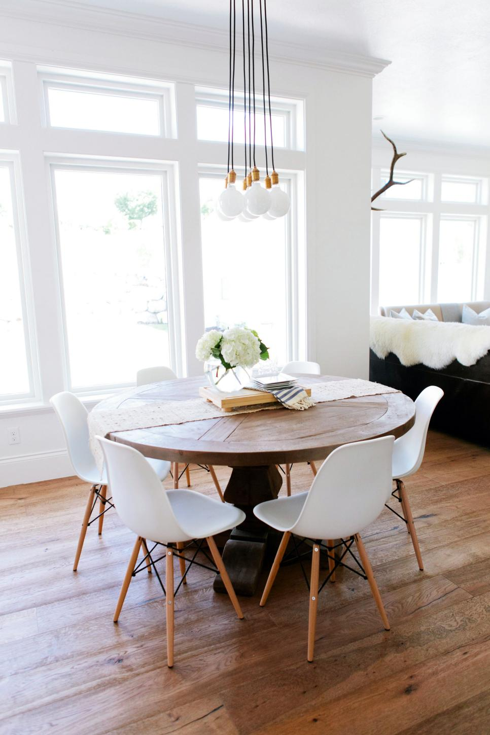 Rustic Round Table With Eames Chairs