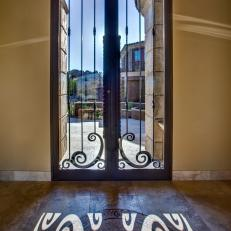 Home Entry with Wrought Iron and Glass Door