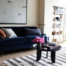 Condo Living Room Features Navy Velvet Sofa