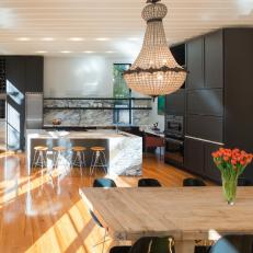 Contemporary Kitchen and Dining Area With Vintage Chandeliers