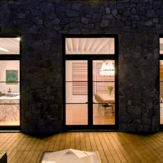 Night View of Contemporary Kitchen and Dining Room From Deck