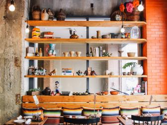 Open Shelves in a Mexican Restaurant Featuring Antique Knickknacks