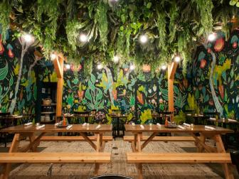 Mexican Restaurant Indoor Patio with Painted Garden Walls and Hanging Ferns