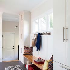 Long, Contemporary Mudroom With Geometric Area Rug