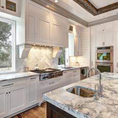 White Kitchen With Carrera Marble Island, Countertops And Backsplash