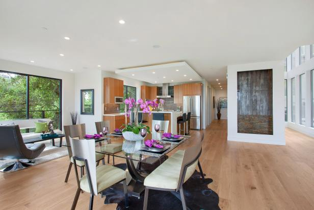 Contemporary White Dining Room With Pink Orchids, Light Hardwood Floor
