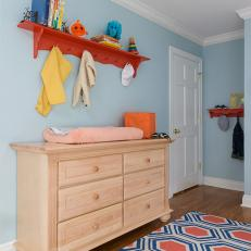 Chic Changing Table in Contemporary Blue Nursery