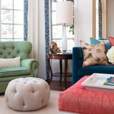 Tufted Ottoman and Green Armchair