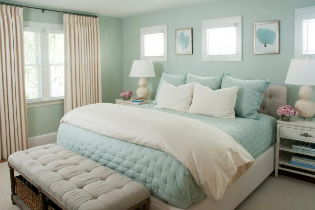 Pale Green Coastal Bedroom With Cream Curtains And Light Blue Bedding