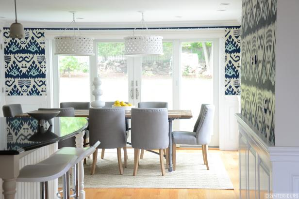 Kitchen Dining Area With Gray Upholstered Chairs and White Chandeliers
