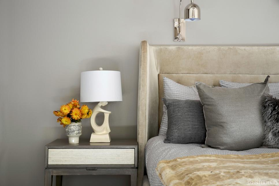 Gray Bedroom With Gray Nightstand and Tan Upholstered Bed