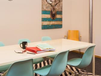 Multicolored Eclectic Conference Room With Blue Chairs