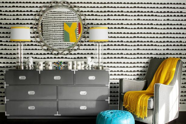 Midcentury Modern Nursery With Gray Dresser, Armchair & Yellow Accents