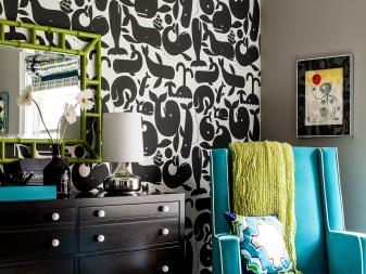 Bold Boy's Nursery With Graphic Whale Wallpaper & Bright Accents