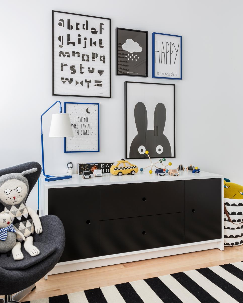 Child's Black-and-White Playroom With Framed Prints