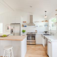 White Open Plan Country Kitchen With Barstools