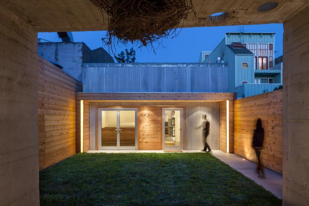 Modern Exterior in Evening With Corrugated Steel & Cedar Siding
