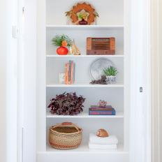 White Built-In Bookshelf With Basket