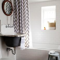 Bright Country Bathroom With Gray and White Chevron Shower Curtain, Animal Hide Rug and Deep Floating Sink