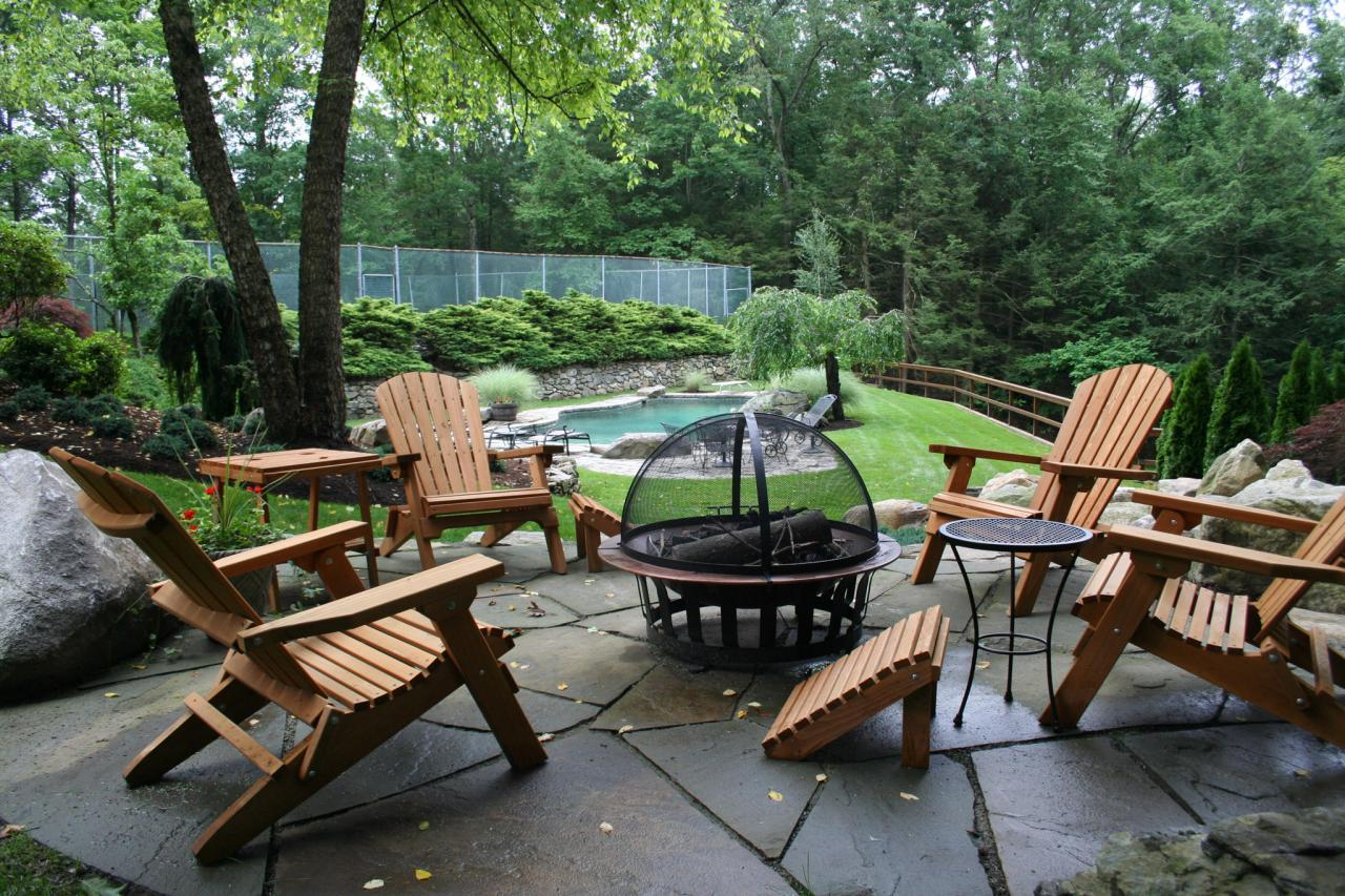 Patio With Wooden Furniture Arrangement And Portable Fire Pit