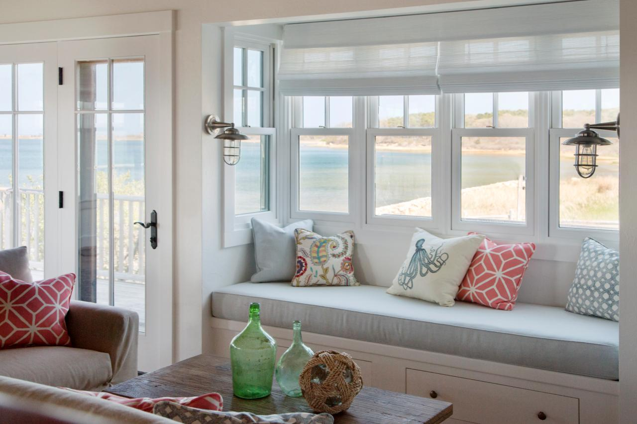 Ocean inspired living room with cozy window seat