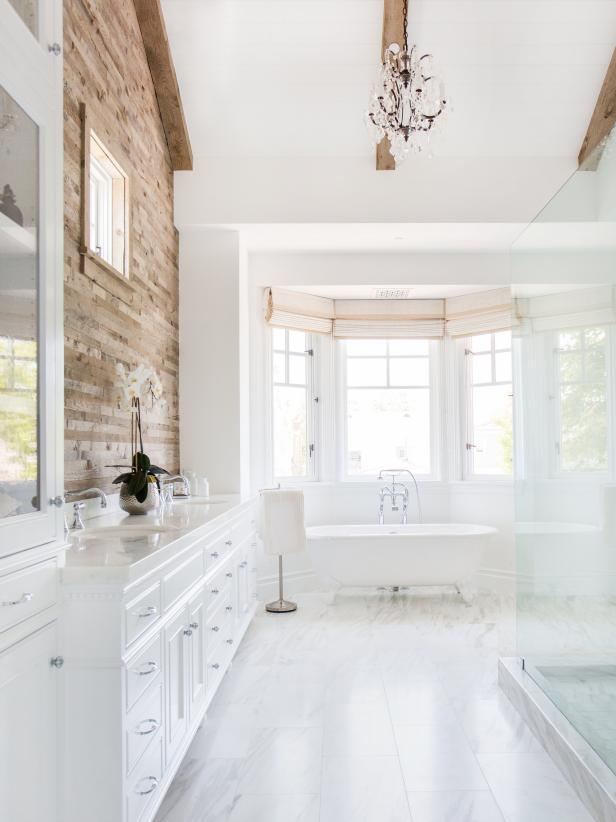 Large White Bathroom With Clawfoot Tub and White Vanity