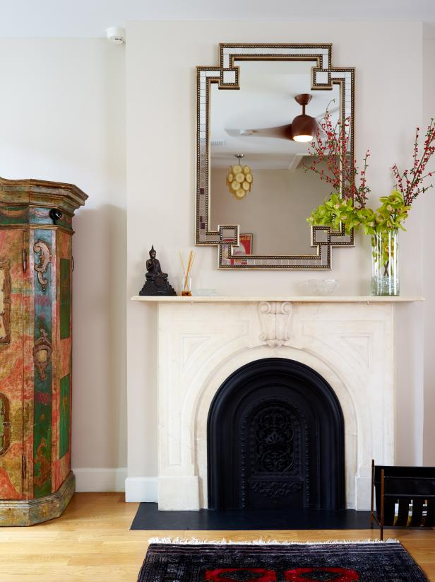 Eclectic Living Space Features Vintage Marble Mantel