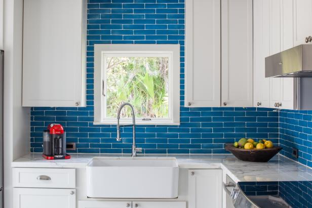Vintage Glam Kitchen with Bright Blue Backsplash