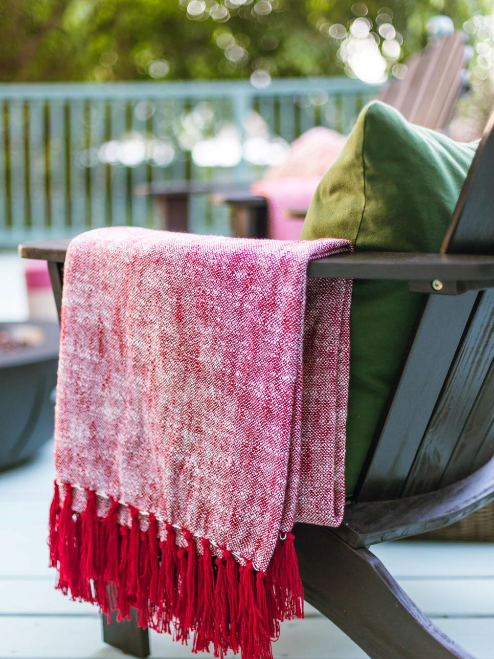 Red Fringed Throw Over Arm of Patio Chair