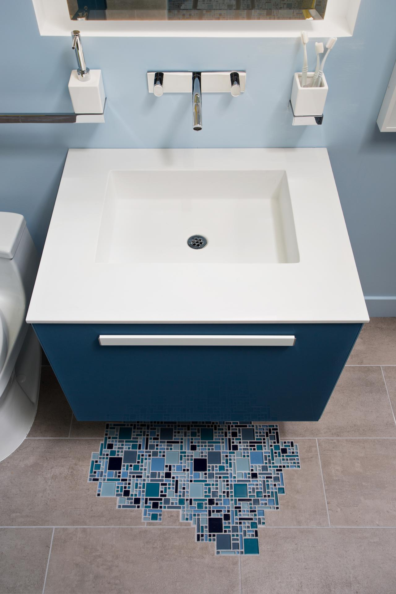 Blue Floating Vanity, Wall-Mounted Faucet and Mosaic Tile Create ...