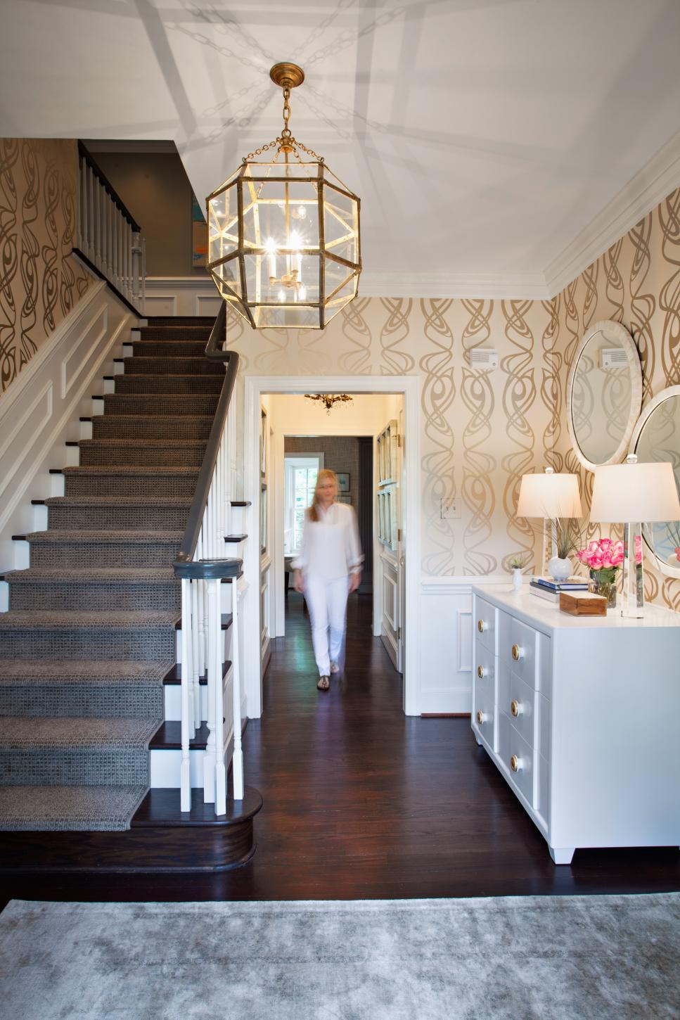 Foyer With Gold Light Fixture and Whimsical Wallpaper