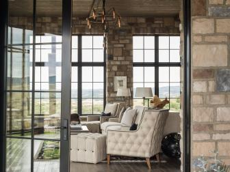 View of Sitting Room Features Cream Chairs & Stone Walls