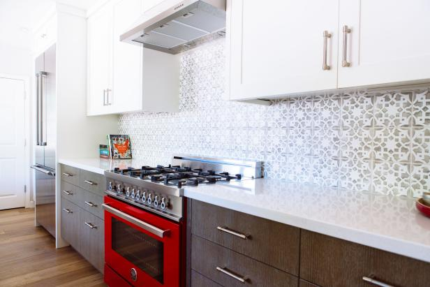Galley Kitchen Features Contrasting Upper & Lower Cabinets and Bright Red Oven