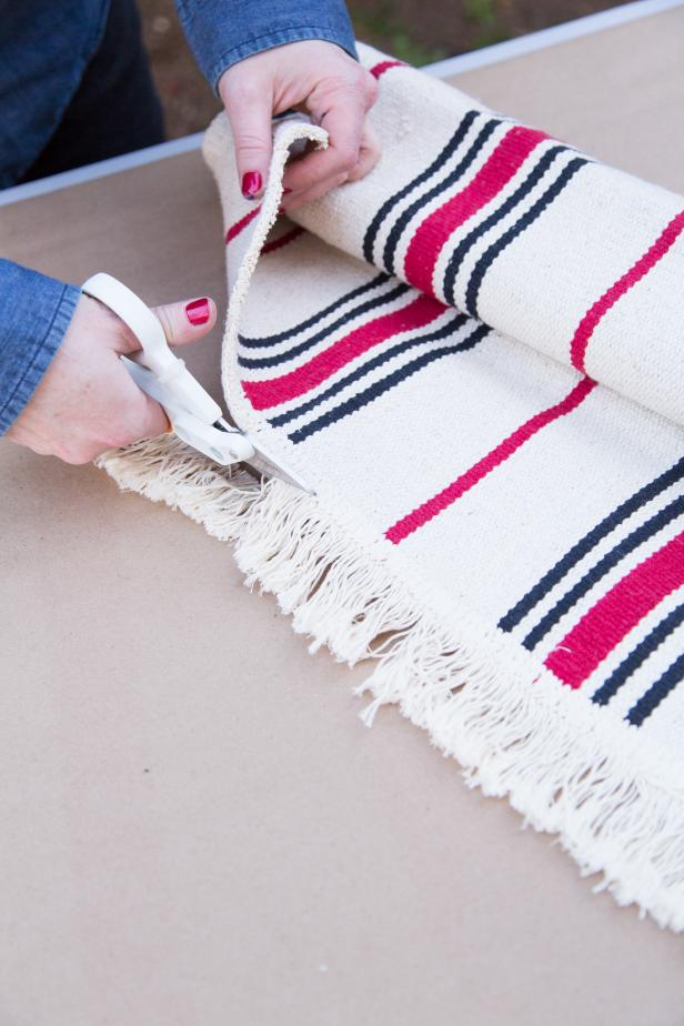 Using sharp scissors, remove the fringe from edges of the rug.