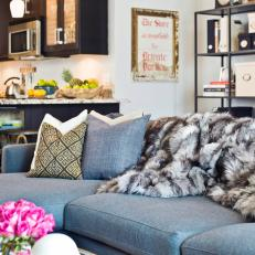 Condo Living Room With Blue Sofa And Faux Fur Blanket