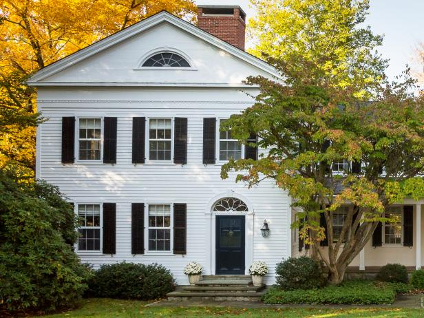 White Colonial House on Tree-Shaded Five-Acre Lot