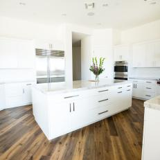 Large Center Island Enriches All-White Kitchen