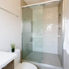 Shower Stall With Modern White Tile Pattern