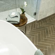 Herringbone Pattern Updates Tile Floor In Bathroom