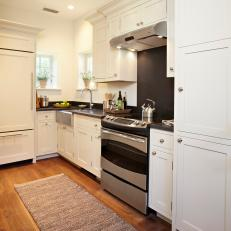 White Galley Kitchen With Honed Black Granite Countertops