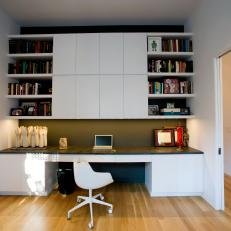 Modern Home Office With Built-In Storage and Pocket Doors