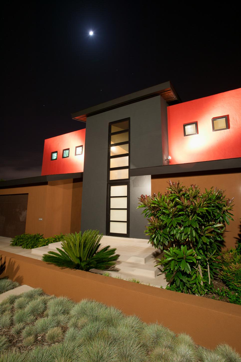 Night View of Modern Red-and-Black House Exterior