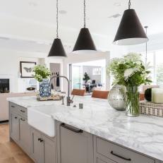 Large Gray Island In Stylish Farmhouse Kitchen