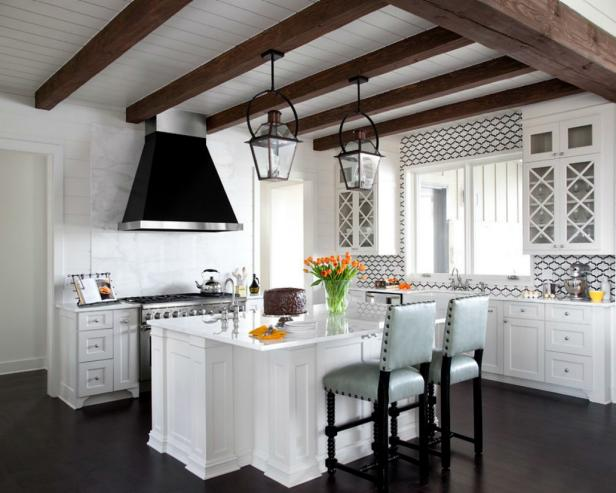 Sophisticated Kitchen With White Cabinets and exposed wood beams