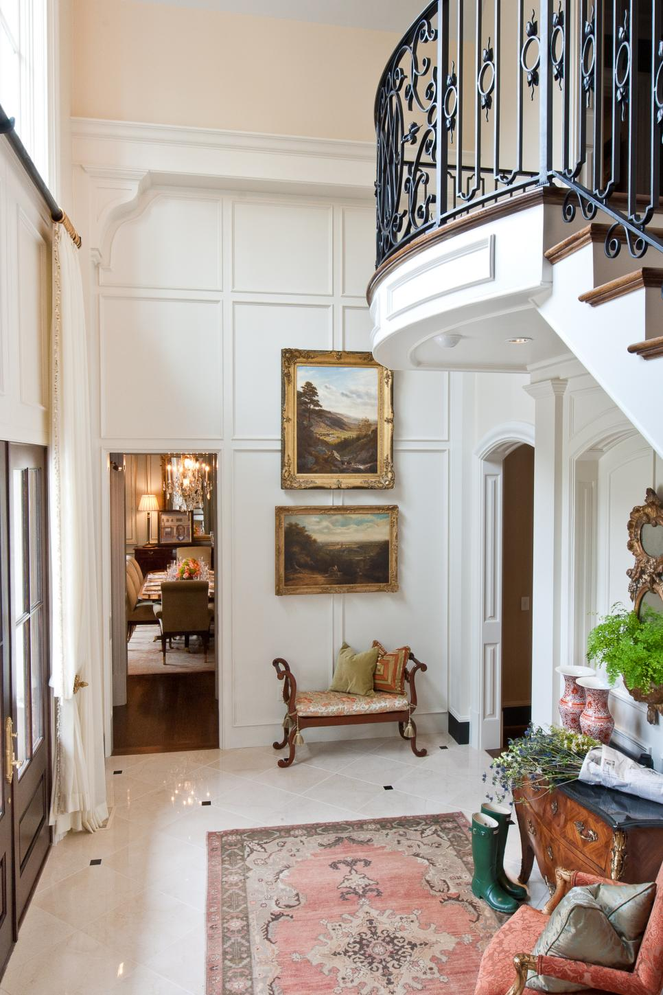 White Traditional Formal Foyer With Tile Floor & Framed Paintings