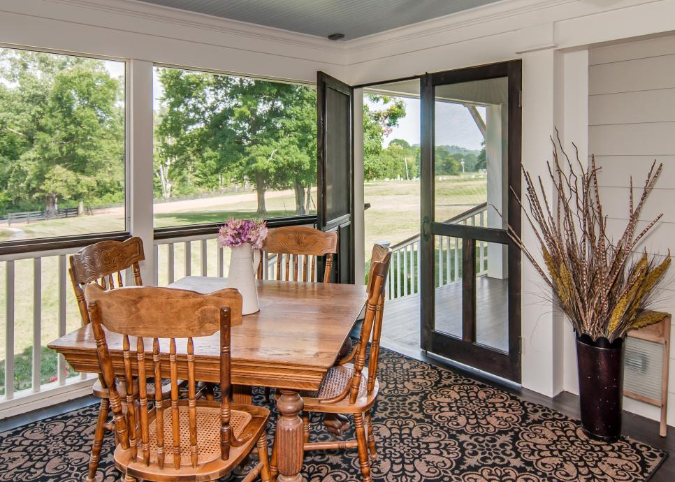 White Screened Porch With Country-Style Wood Dining Table