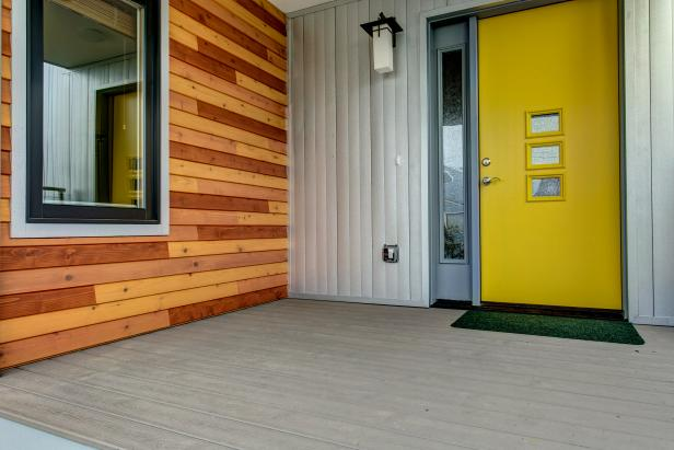 Modern Exterior with Canary Yellow Front Door