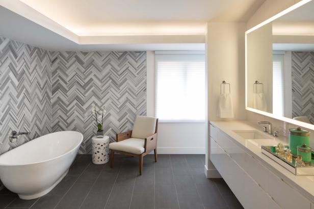 Herringbone Tile Wall Uplifts Modern Master Bathroom